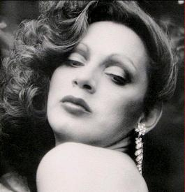 "Holly Woodlawn: ""Holly came from Miami, F.L.A. Hitch-hiked her way across the U.S.A. Plucked her eyebrows on the way Shaved her legs and then he was a she"" Click for source."