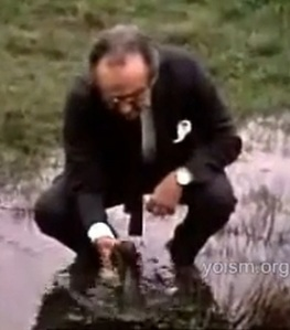 Jacob Bronowski outside Auschwitz, pondering the folly of absolutism.  From BBC The Ascent of Man. via Youtube. Click for source